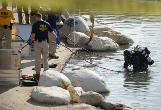 Image: FBI Underwater Search and Evidence Response Team work in Seccombe Lake