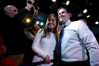 Image: Republican presidential candidate Senator Marco Rubio (R-Fla.) takes a photo with Iowa State University student Kelsi Wolever, 21, after speaking at a campaign event at the Maintenance Shop at Iowa State University in Ames