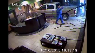 IMAGE: Driver walks away after ramming Oklahoma hotel desk with truck