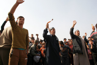 Image: Displaced Ramadi residents celebrate Tuesday after their city was liberated from ISIS.