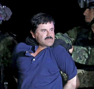 "Image: Recaptured drug lord Joaquin ""El Chapo"" Guzman is escorted by soldiers during a presentation in Mexico City"