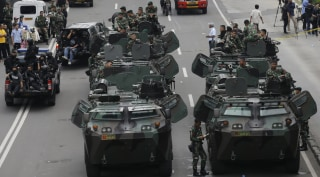 Image: Soldiers man armored vehicles near the site of the attacks in Jakarta, Indonesia Thursday.