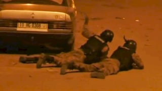 Image: Security officers take their positions outside Splendid Hotel in Ouagadougou
