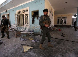 Image: Afghan security forces inspect the site of a suicide attack in Jalalabad