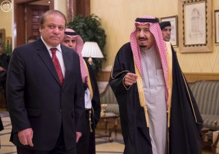 Image: Handout photo of Saudi King Salman welcoming Pakistani Prime Minister Nawaz Sharif in Riyadh