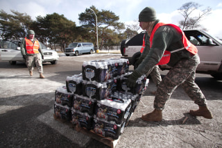 Image: Soldiers from the Michigan Army National Guard Flint prepare to give Flint residents bottled water