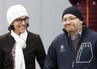 Image: U.S. journalist Jason Rezaian smiles next to his wife Yeganeh Salehi