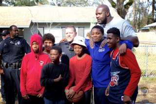 Image: Shaq plays basketball with Florida kids