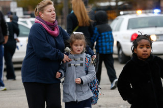 Image: Students at Amy Beverland Elementary School are picked up after school after a bus accident