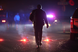 Image: Sergeant Tom Hutchison walks towards an Oregon State Police roadblock