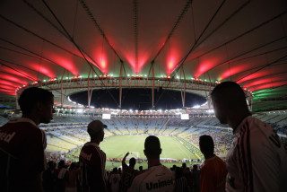 Image: Fans watch a soccer match in Maracanã stadium