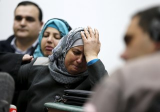 Image: Suha, mother of Palestinian youth, Mohammed Abu Khudair reacts after the sentencing of two of her son's murderers at the Jerusalem District Court in Jerusalem