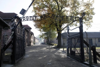 "Image: The entrance  with the inscription ""Arbeit Macht Frei"" (Work Sets You Free) gate of the former German Nazi death camp of Auschwitz"