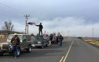 Image: People wave American flags near the Malheur National Wildlife Refuge