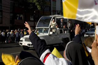 Image: Nuns and faithful wave to Pope Francis