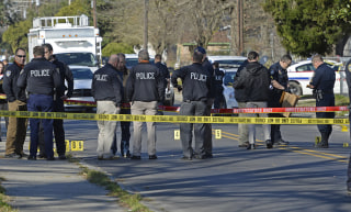 Image: Officers investigate the scene of a shooting in Baton Rouge
