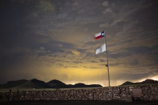 Image: A Texas state flag flies at an entrance to Cibolo Creek Ranch, Texas, in this 2015 photo.