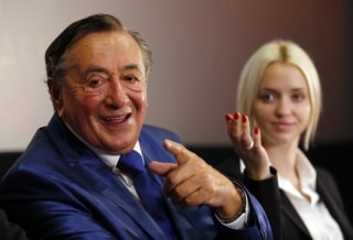 Image: Austrian businessman Lugner and his wife Cathy address a news conference on his announcement to run for Austrian president in Vienna