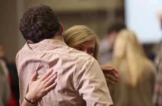 Image: Supporters of Republican presidential candidate Jeb Bush console each other after Bush abandoned his quest for the White House and suspended his presidential campaign at his South Carolina primary night party in Columbia