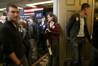 Image: Supporters of Republican presidential candidate Jeb Bush leave the room after Bush abandoned his quest for the White House and suspended his presidential campaign at his South Carolina primary night party in Columbia