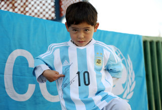 Image: Messi gives Jersey to Afghan Boy
