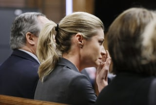 Image: Erin Andrews wipes tears