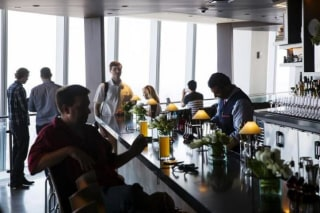 Visitors sit down at a restaurant in the newly opened One World Trade Observatory in the Manhattan borough of New York