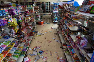 Image: Packaged items lie on the floor of a convenience store in Futaba, Japan