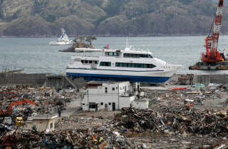 Image: A sightseeing boat which was swept onto the roof of a guesthouse by the tsunami in Otsuchi
