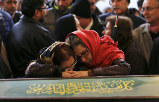 Image: Women mourn over the coffin of a car bombing victim during a commemoration ceremony in a mosque in Ankara