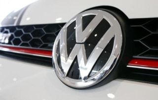 Logo of German carmaker Volkswagen is seen on a VW Golf GTI car at a showroom of AMAG in Duebendorf