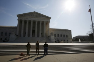 Image: Three anti-abortion protestors are seen outside U.S. Supreme Court building is seen in Washington