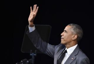Image: Obama waves before delivering a speech at the Gran Teatro de la Habana