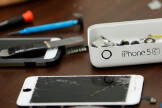 Pieces of an iPhone are seen on a repair store in New York