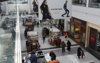 People are seen walking through Roosevelt Field shopping mall in Garden City, New York