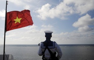 Image: File photo of a Vietnamese naval soldier standing quard