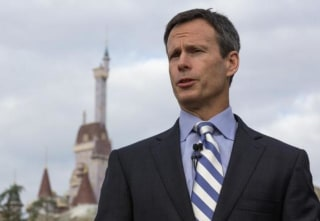 File photo of Tom Staggs, Chief Operating Officer of Walt Disney Co., speaks during a ribbon-cutting ceremony for the New Fantasyland in Lake Buena Vista, Florida