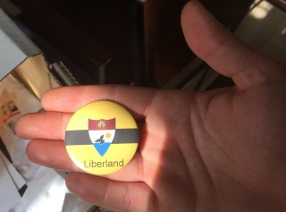 Image: A button bearing the symbol of Liberland