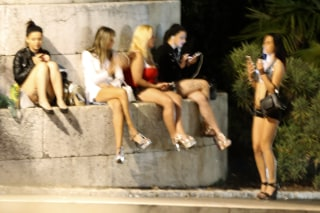 Image: Prostitutes wait for clients on a street
