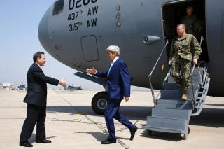 Image: Ambassador Stuart Jones greeted Kerry in Baghdad.