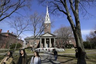 Image: People walk on the campus of Harvard University