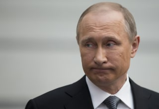 Image: Russian President Vladimir Putin grimaces as he speaks to the media after his annual call-in show in Moscow