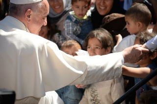 Image: Pope Francis greets migrants and refugees at the Moria refugee camp on Saturday.
