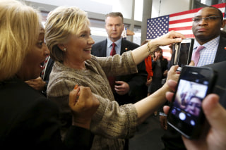 Image: Democratic U.S. presidential candidate Hillary Clinton takes photographs with supporters at Southwest College in Los Angeles