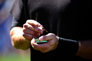 Image: Pat Burrell of the San Francisco Giants uses smokeless tobacco during warm ups
