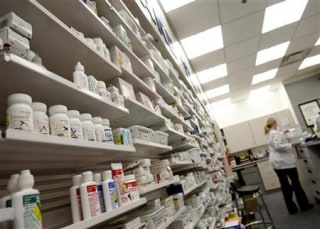 A pharmacist works at a pharmacy in Toronto