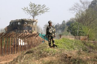 Image: A Border Security Force or BSF soldier stands guard along the India-Pakistan border