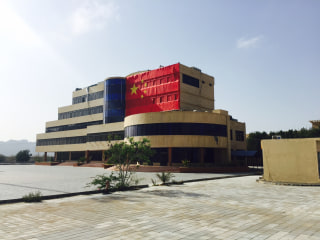 Image: A Chinese flag hangs on the Gwadar Port Authority building