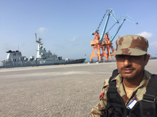 Image: A paramilitary soldier stands guard at Gwadar Port
