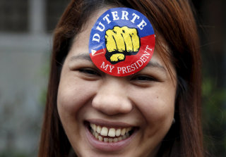 Image: A supporter of presidential candidate Rodrigo Duterte